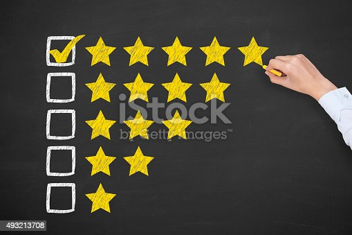istock Rating Five Golden Stars on Chalkboard 493213708