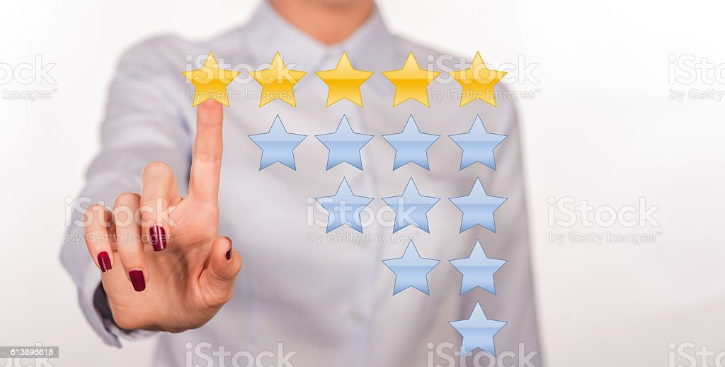 Rating Stars. Business hand clicking rating. Customer review concept. S stock photo