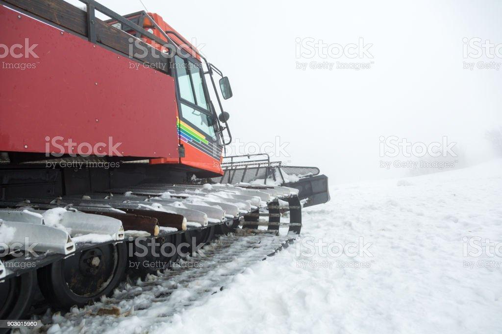 Ratrak in a winter mountain resort. stock photo