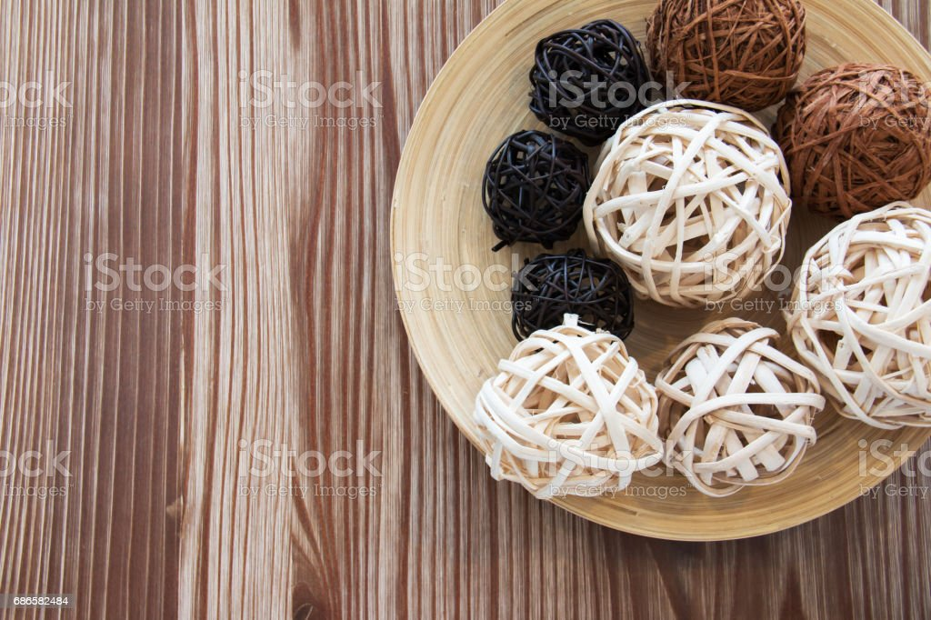 Rattan ball on wooden plate for decoration. royalty-free stock photo