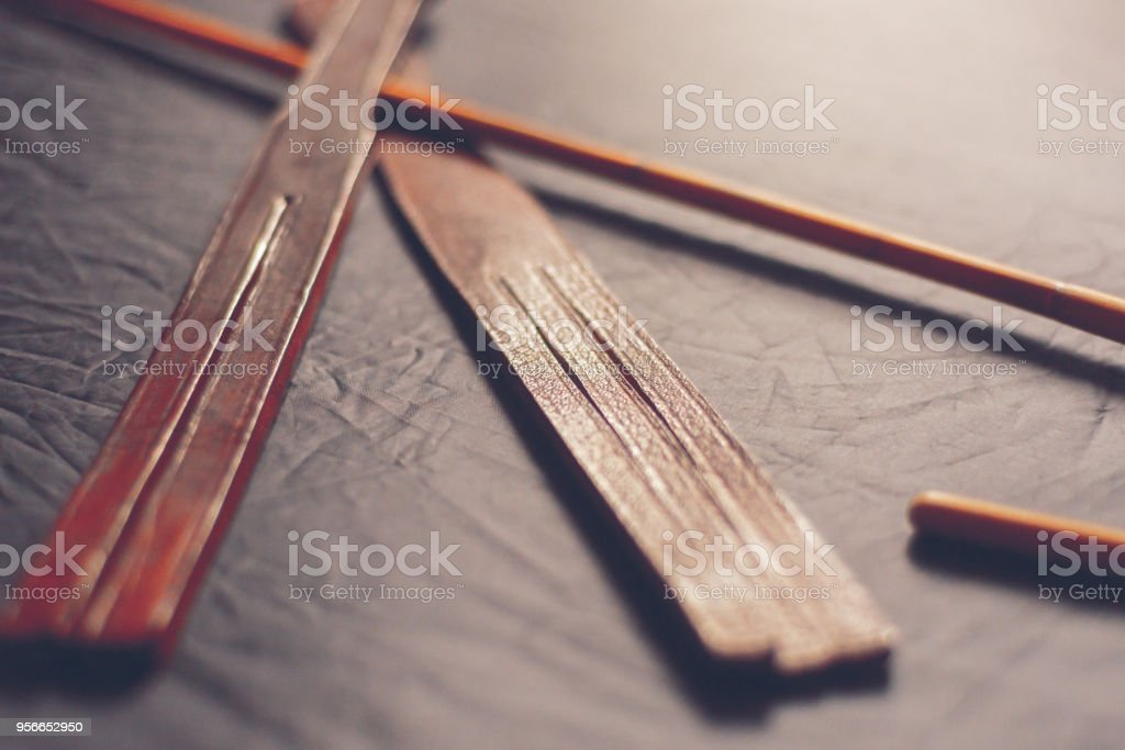 rattan cane and leather tawse for punishment stock photo