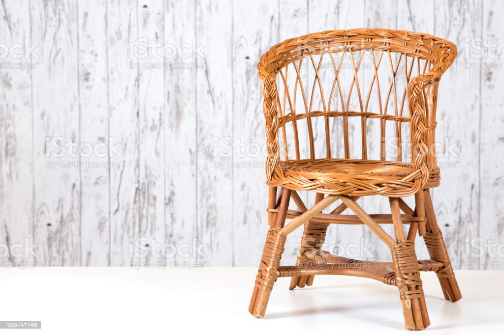 Rattan chair and furniture on concrete floor