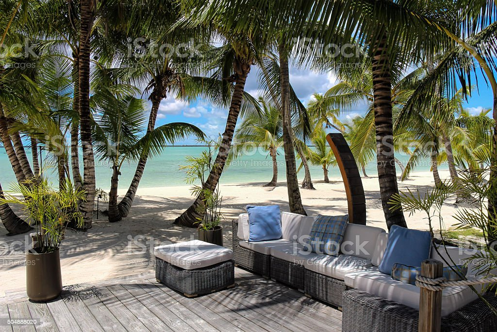 Rattan chairs on a wooden deck near the beach stock photo