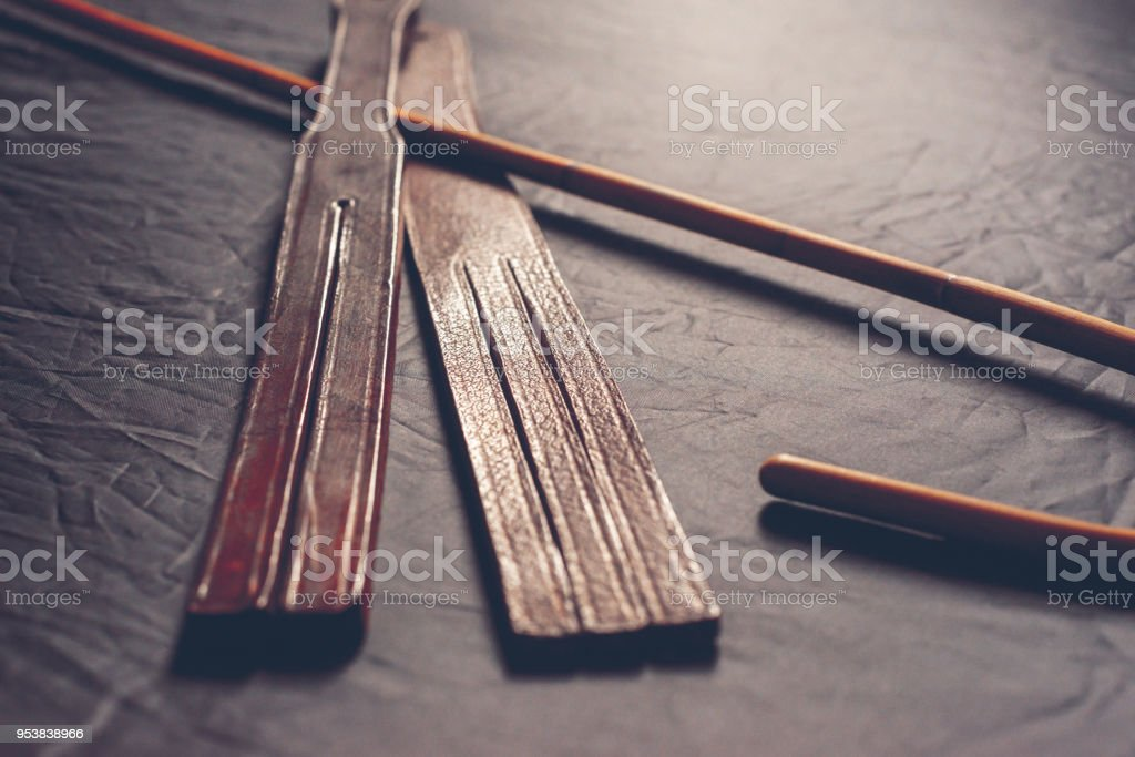 Rattan school cane and leather tawse. corporal punishment concept stock photo
