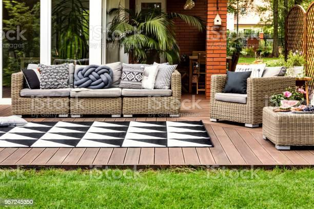 Rattan sofa on terrace picture id957245350?b=1&k=6&m=957245350&s=612x612&h=qqjdzna9suzfmotyqhlxlbno vzt3mxdswy0j1brrgs=