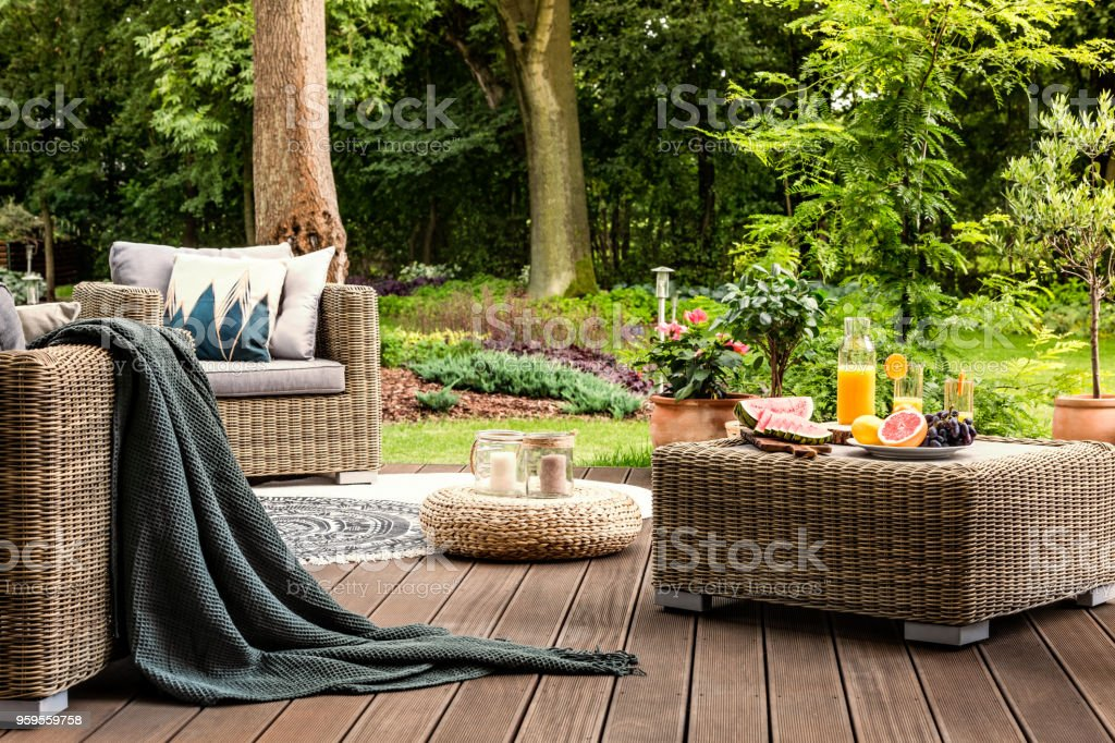 Rattan table with fruit stock photo