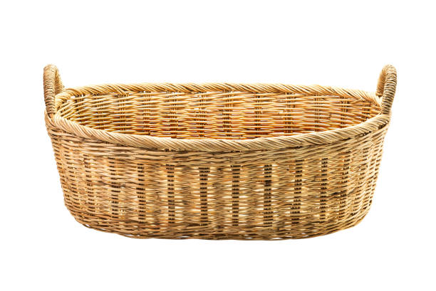 Rattan wicker basket Rattan wicker basket for cloth isolated on white background with clipping path laundry basket stock pictures, royalty-free photos & images