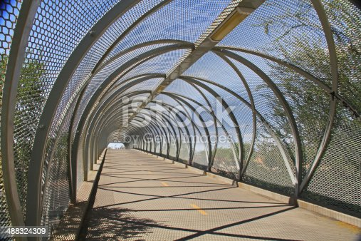 Inside the tail end of the diamondback rattlesnake bicycle and pedestrian covered bridge over Broadway Blvd. at the Barraza-Aviation Parkway, just east of downtown Tucson, Arizona.