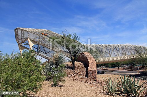 Head end of the diamondback rattlesnake bicycle and pedestrian covered bridge over Broadway Blvd. at the Barraza-Aviation Parkway, just east of downtown Tucson, Arizona.