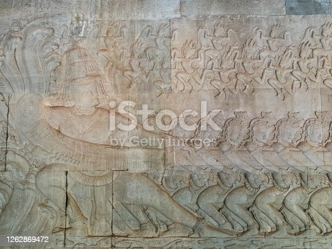 Bas-relief of Ravana holding the head of the serpent at Angkor Wat - Siem Reap, Cambodia