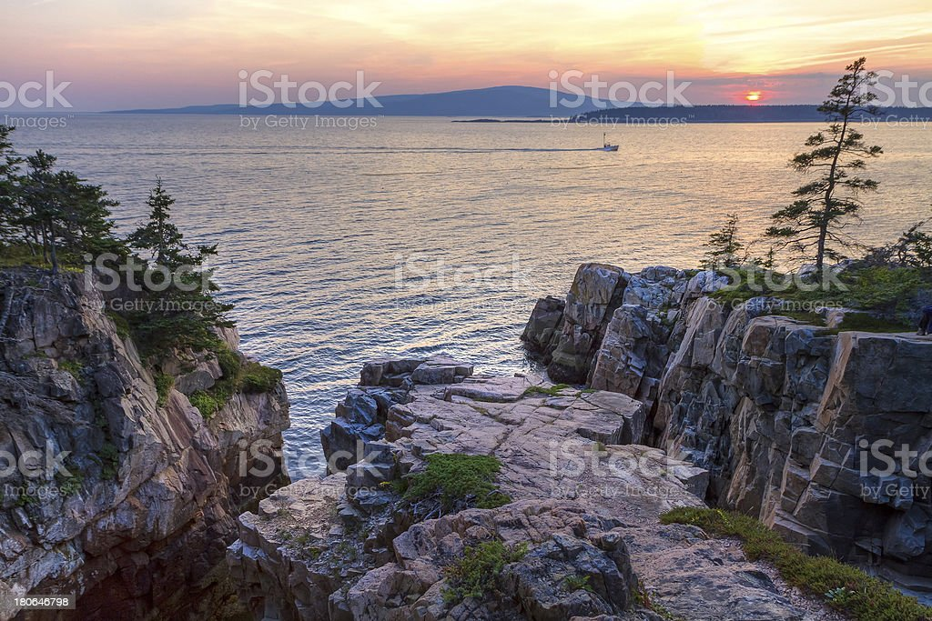 Raven's Nest Sunset and Fishing Boat stock photo