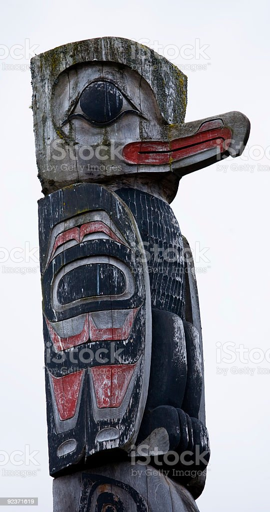 Raven-topped Alaskan Totum Pole royalty-free stock photo