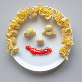 istock Ravioli face with ketchup smile 1285082237