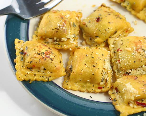 Ravioli on a plate stock photo