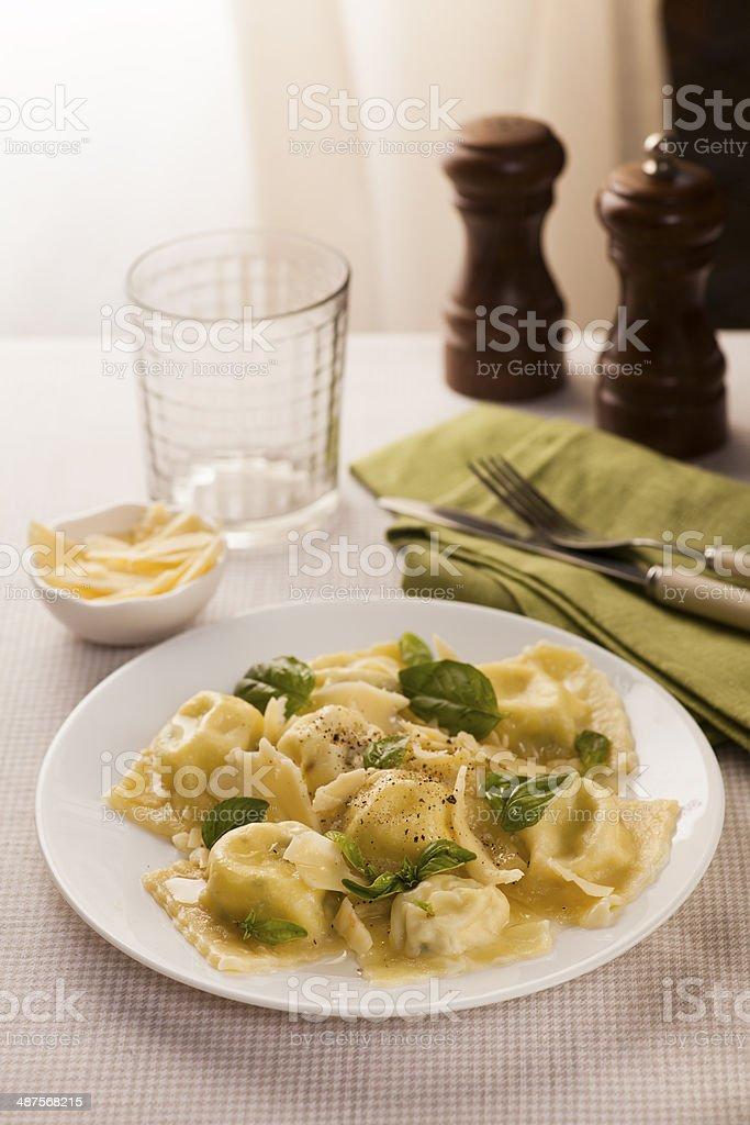 Ravioli pasta with cheese and basil. Italian food stock photo