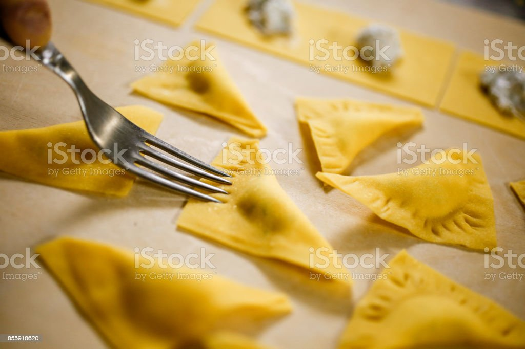 Ravioli. Typical Italian homemade fresh stuffed pasta in the preparation process at the moment of closing stock photo