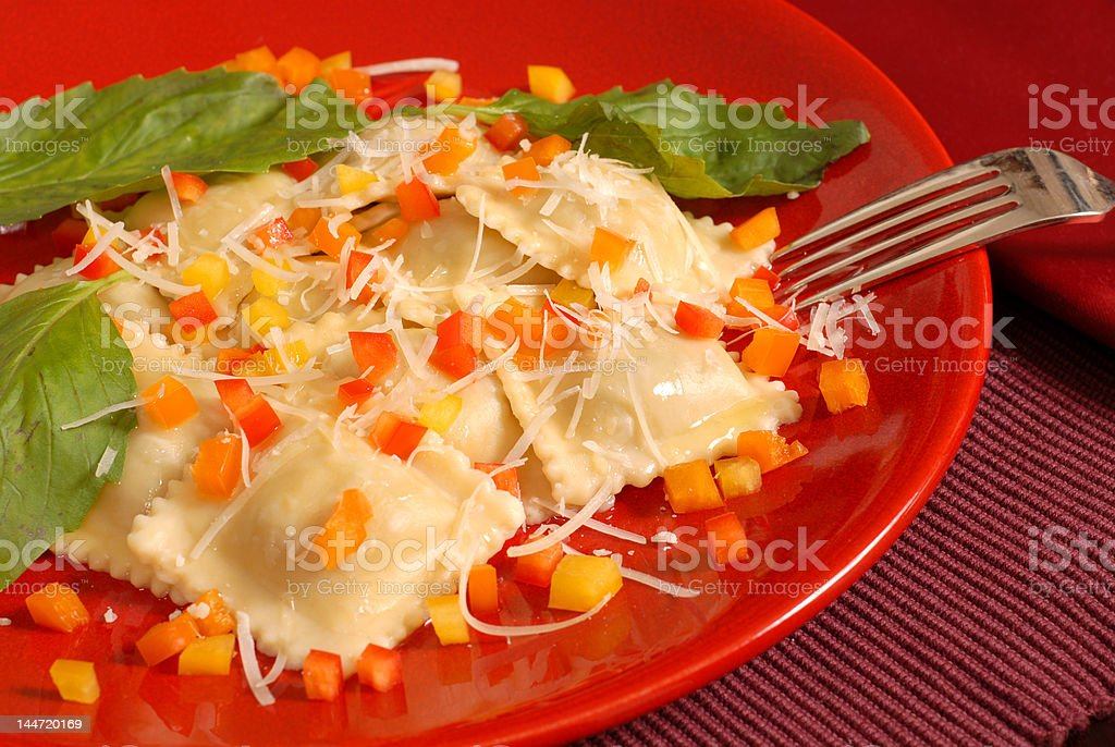 Ravioli with diced peppers and basil royalty-free stock photo
