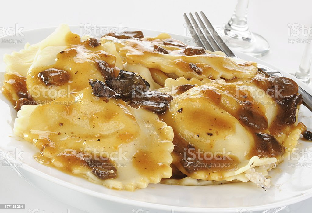 Ravioli with mushroom sauce stock photo