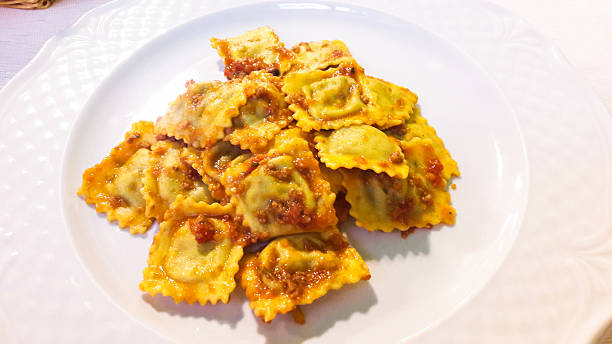 Ravioli with ragout sauce, Italian Cuisine Ravioli with ragout sauce, Italian Cuisine ragout stock pictures, royalty-free photos & images