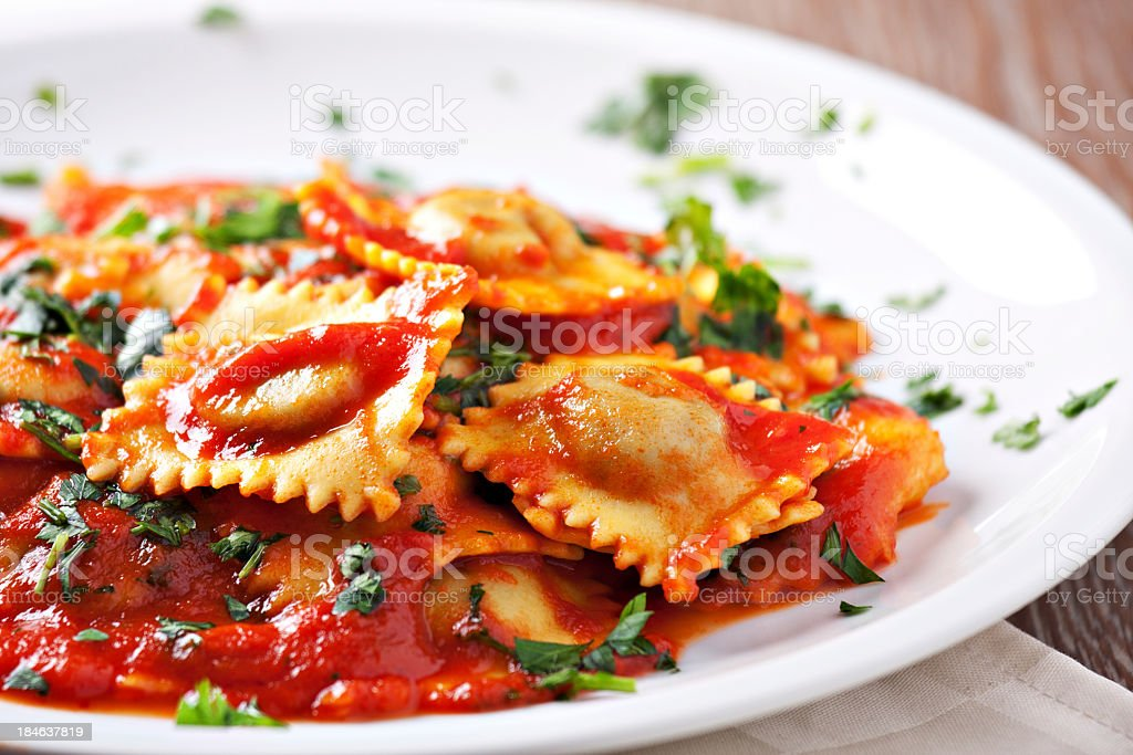 Ravioli with tomato sauce stock photo