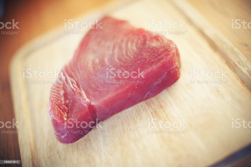 Raw Ahi Tuna On A Cutting Board stock photo