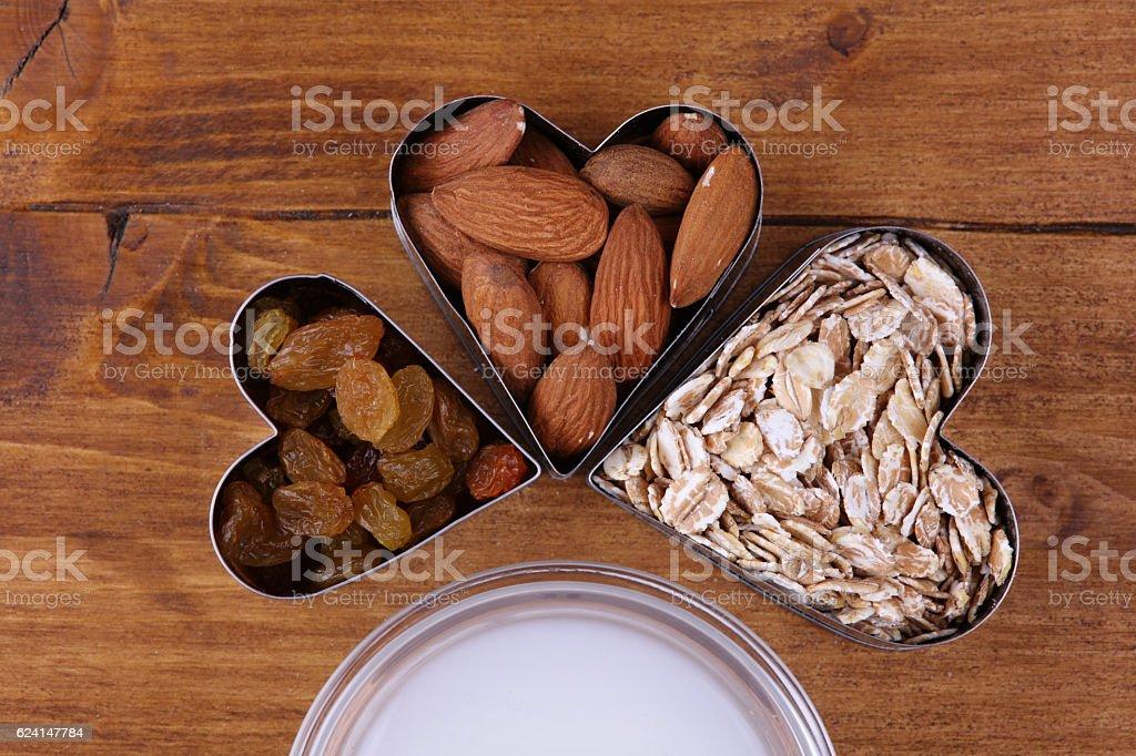 Raw almond and whole grain cereals , raisins and coconut milk stock photo