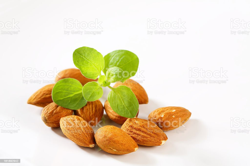 Raw almonds on a white background royalty-free stock photo