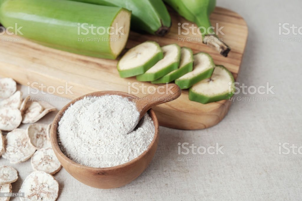 Raw and dried green bananas, plantain flour, resistant flour, prebiotic food stock photo