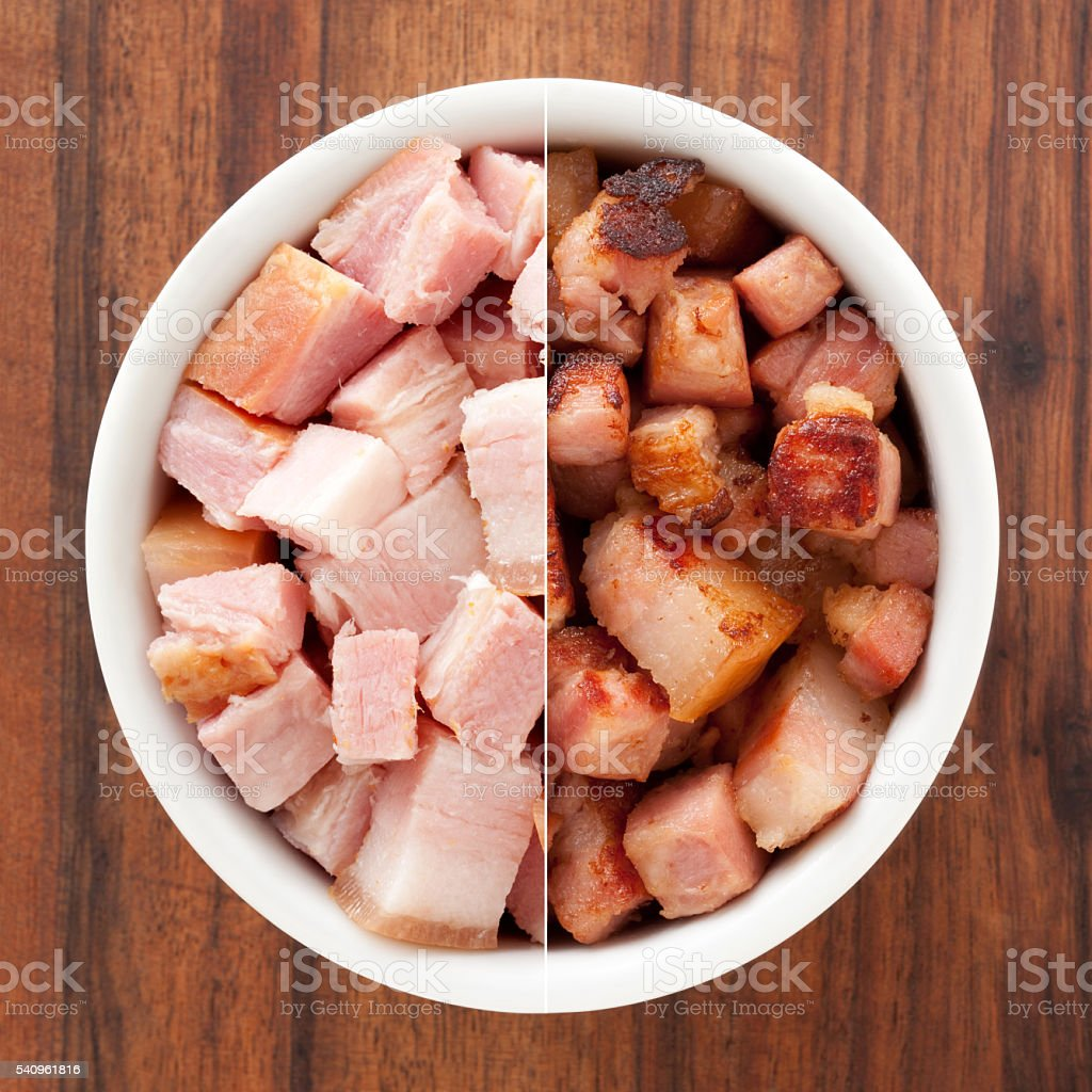 Raw and fried bacon cubes composition stock photo
