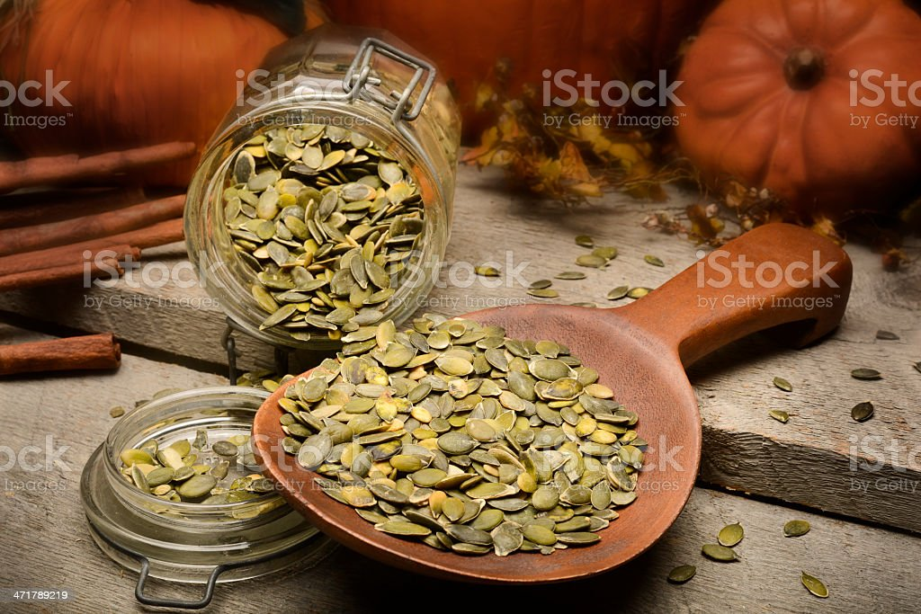 Raw and roasted pumpkin seeds stock photo