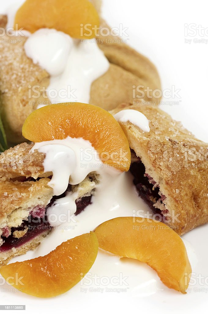 Raw apricot and tasty cake on the white royalty-free stock photo