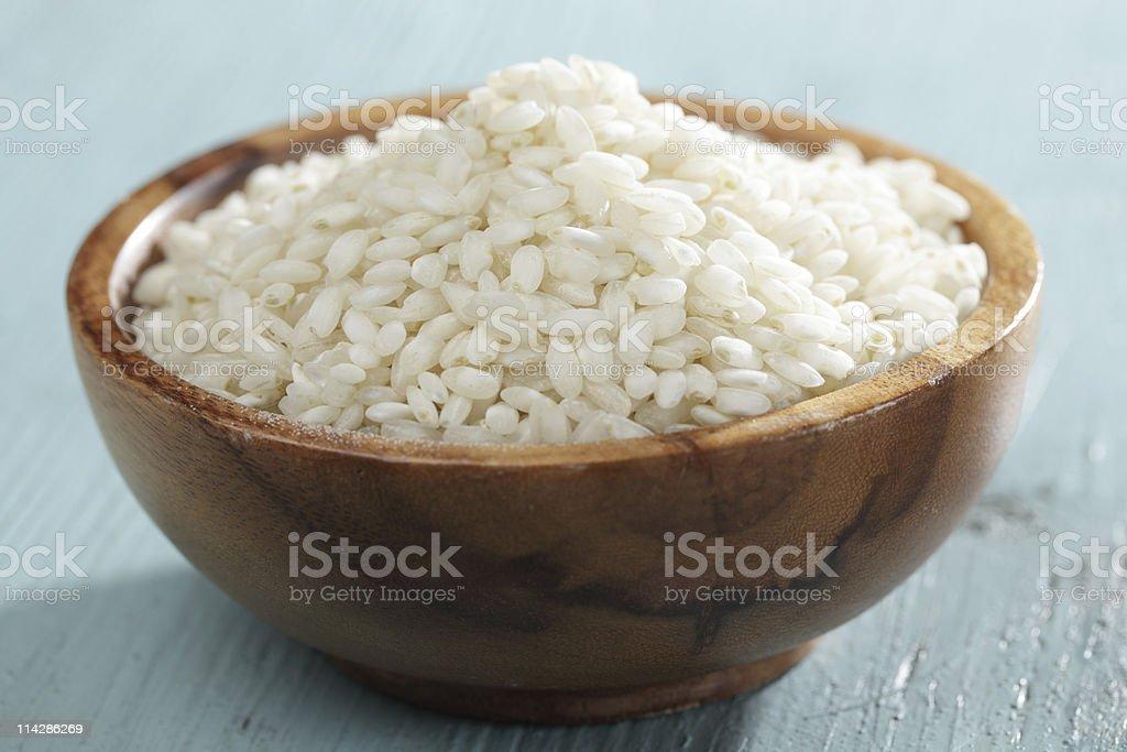 Raw arborio rice in bamboo bowl royalty-free stock photo