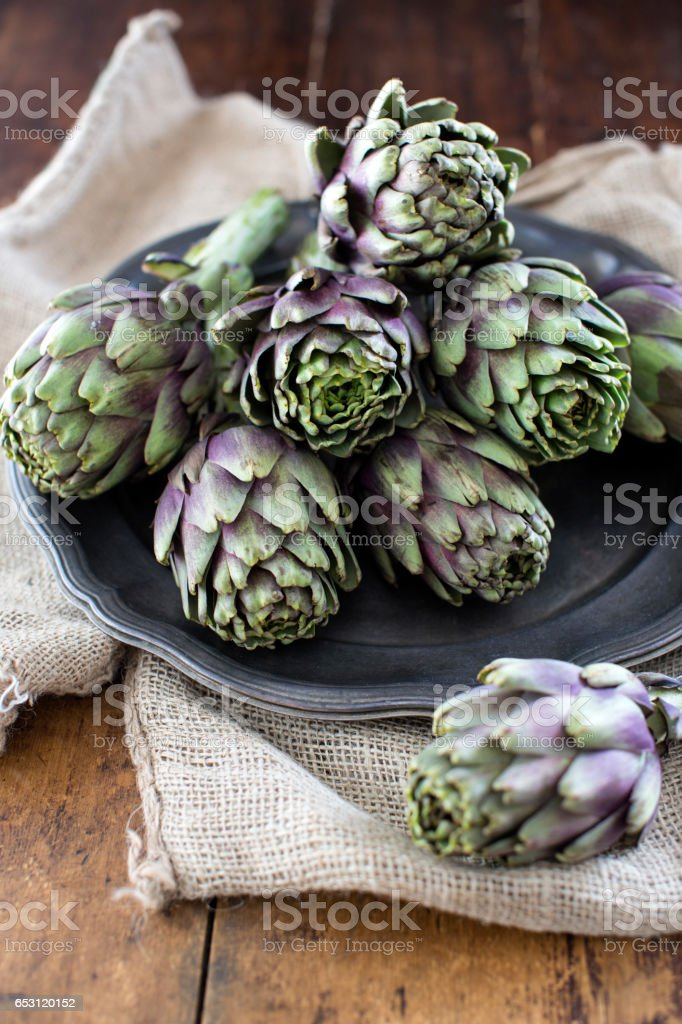 raw artichokes stock photo
