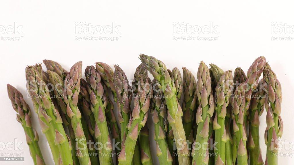 raw asparagus on white background royalty-free stock photo