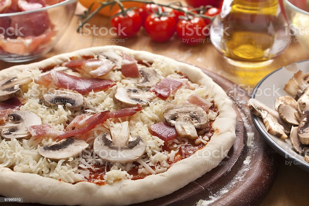 raw bacon and mushrooms pizza royalty-free stock photo
