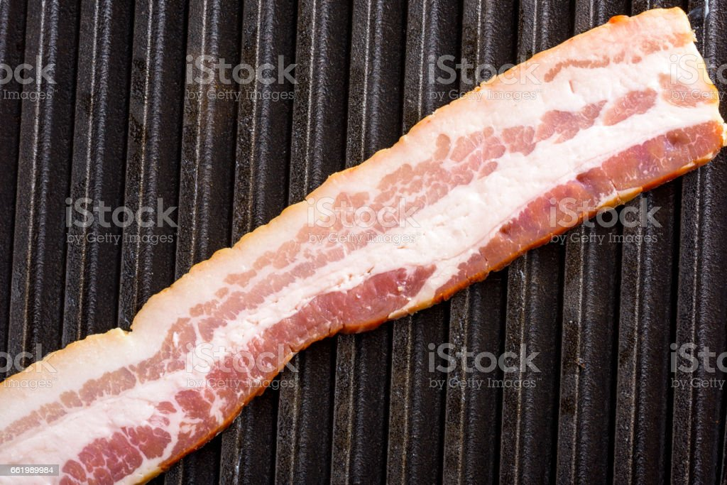 Raw Bacon on grill royalty-free stock photo