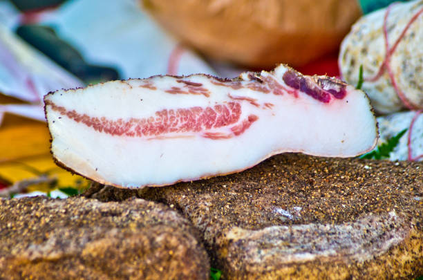 raw bacon ready to flavor your recipes stock photo