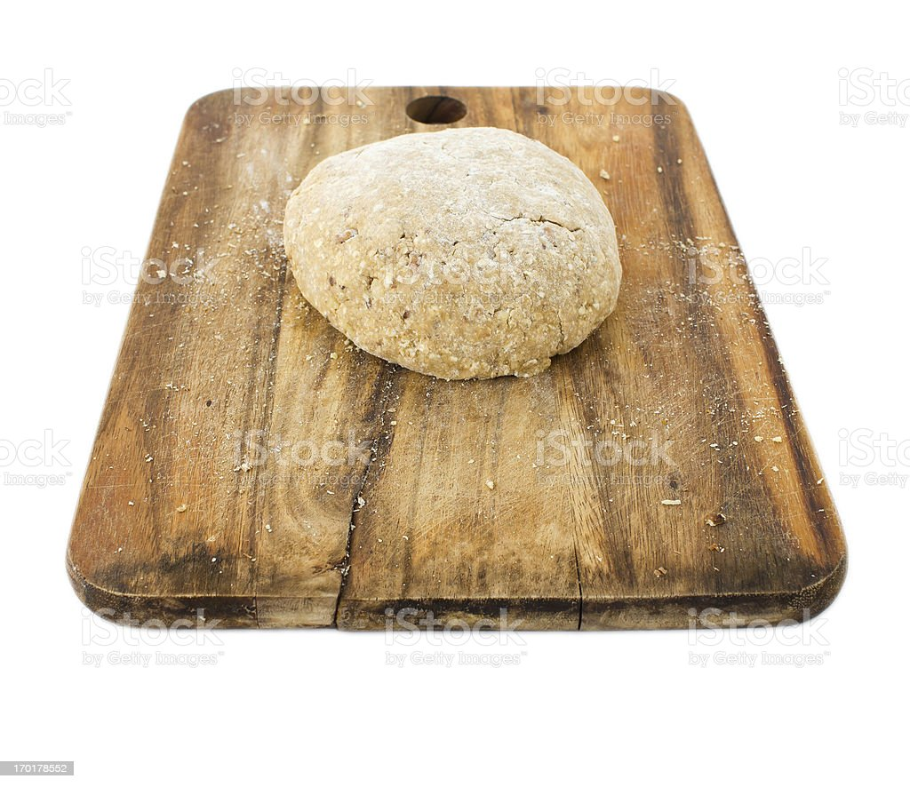 Raw ball of dough on wooden board isolated royalty-free stock photo