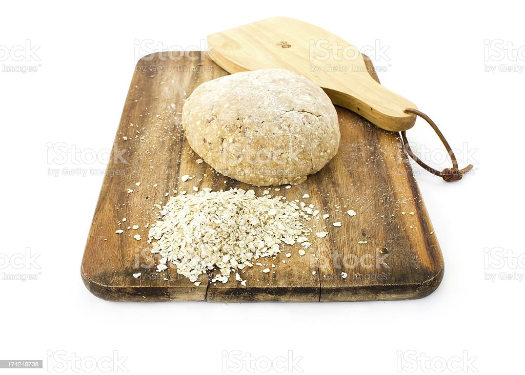 Raw ball of dough on wooden board royalty-free stock photo