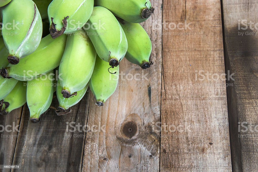 raw banana on wood background stock photo