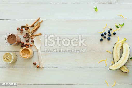 istock Raw banana, peanut butter, fascination on table 665225618