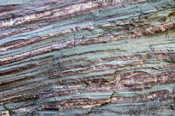 Raw Banded Iron Ore In Sedimentary Layers Of Rock stock photo