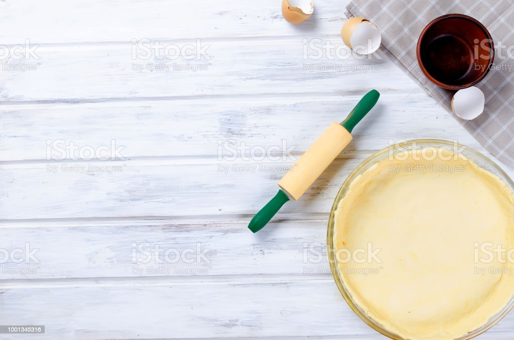 raw base of pastry for baking in a baking dish