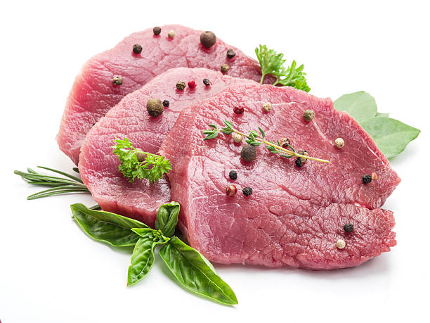 Raw beaf steaks with spices. stock photo