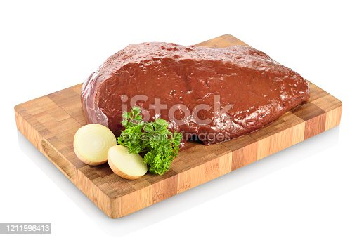 Raw beef liver, ready to be cooked. On a cutting board with chopped onions and parsley aside. Isolated on white background.