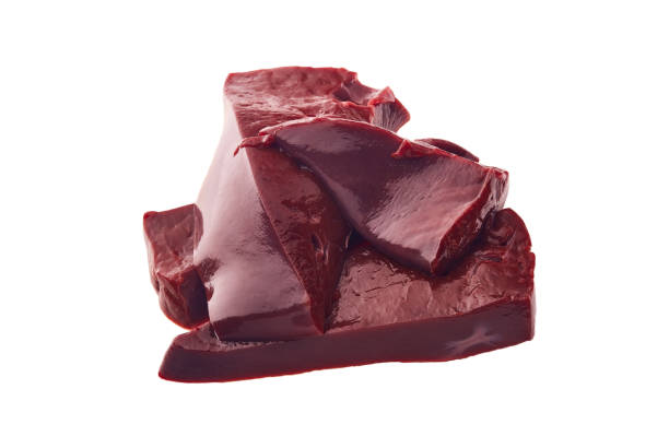 Raw beef livers on  white background. stock photo