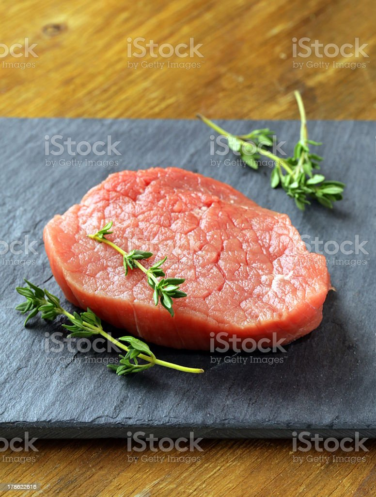 raw beef meat on cutting board royalty-free stock photo