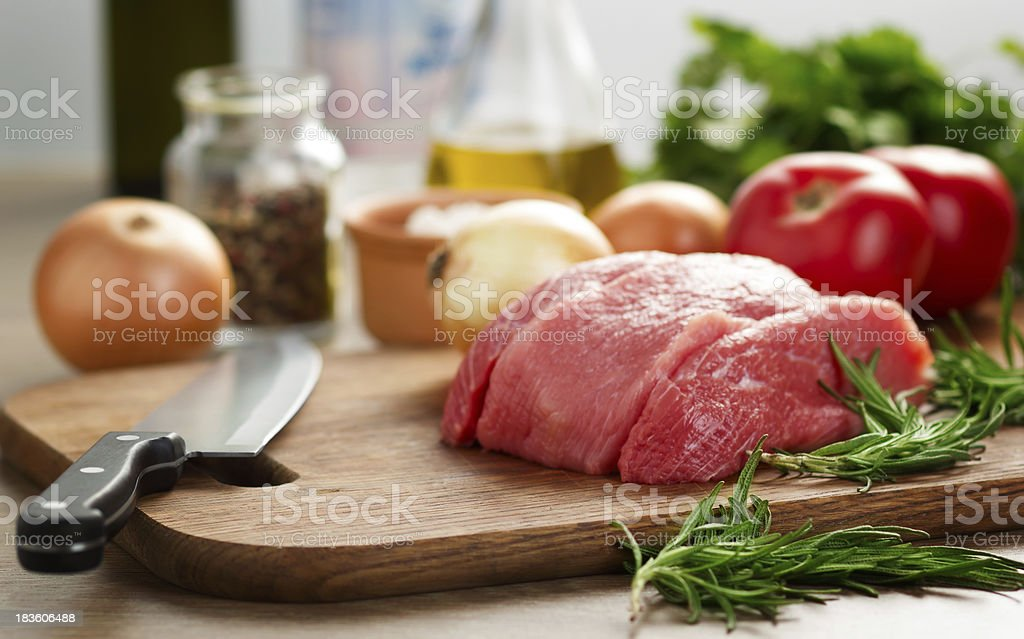 Raw beef on cutting board royalty-free stock photo
