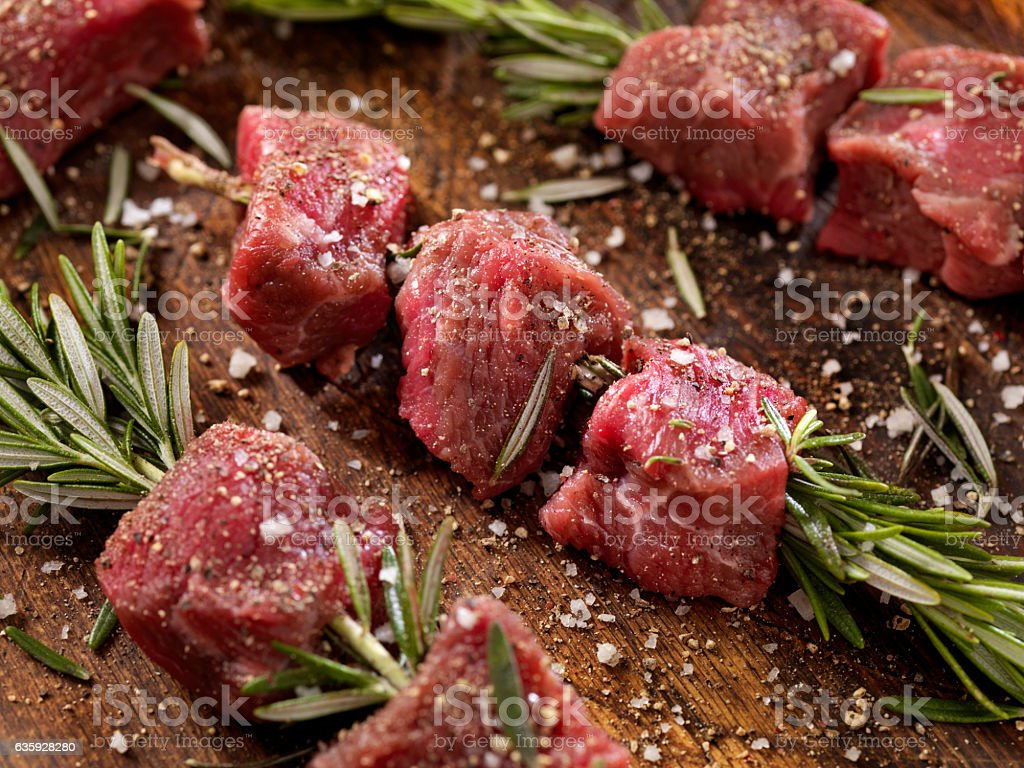 Raw Beef Rosemary Skewers stock photo