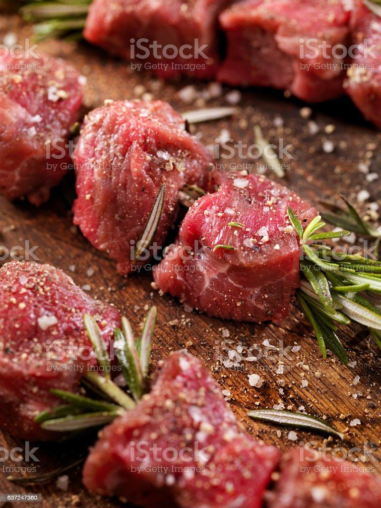 Raw Beef Rosemary Skewers stock photo